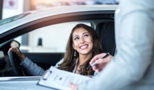 happy-customer-buying-brand-new-car-local-car-dealership-1